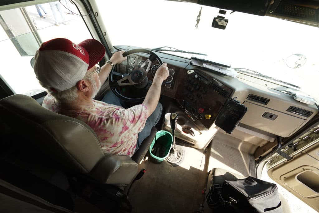 Driver behind the wheel of a Sisbro truck