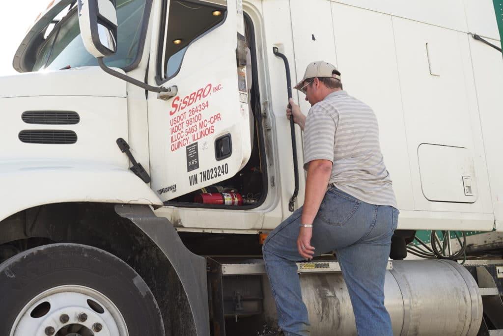 Sisbro driver climbing into his truck