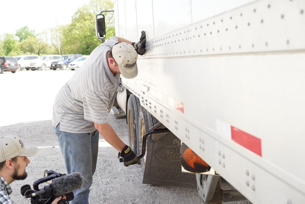 Sisbro truck driver maintaining truck