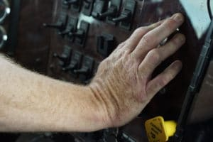 Truck driver's hand on console