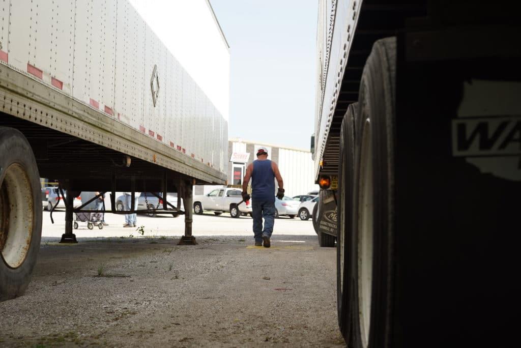 Sisbro truck driver walks around trailer