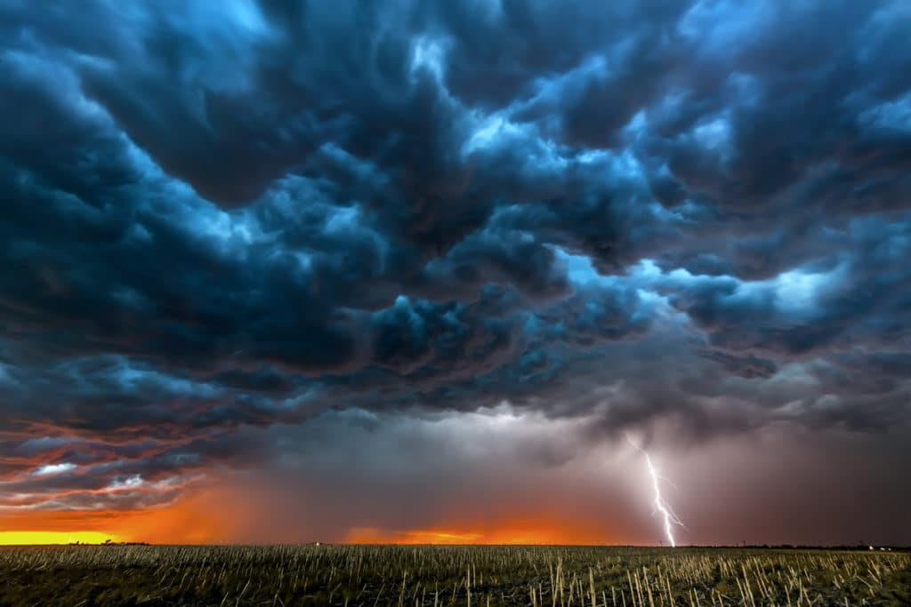 vicious looking storm with lightning over a field