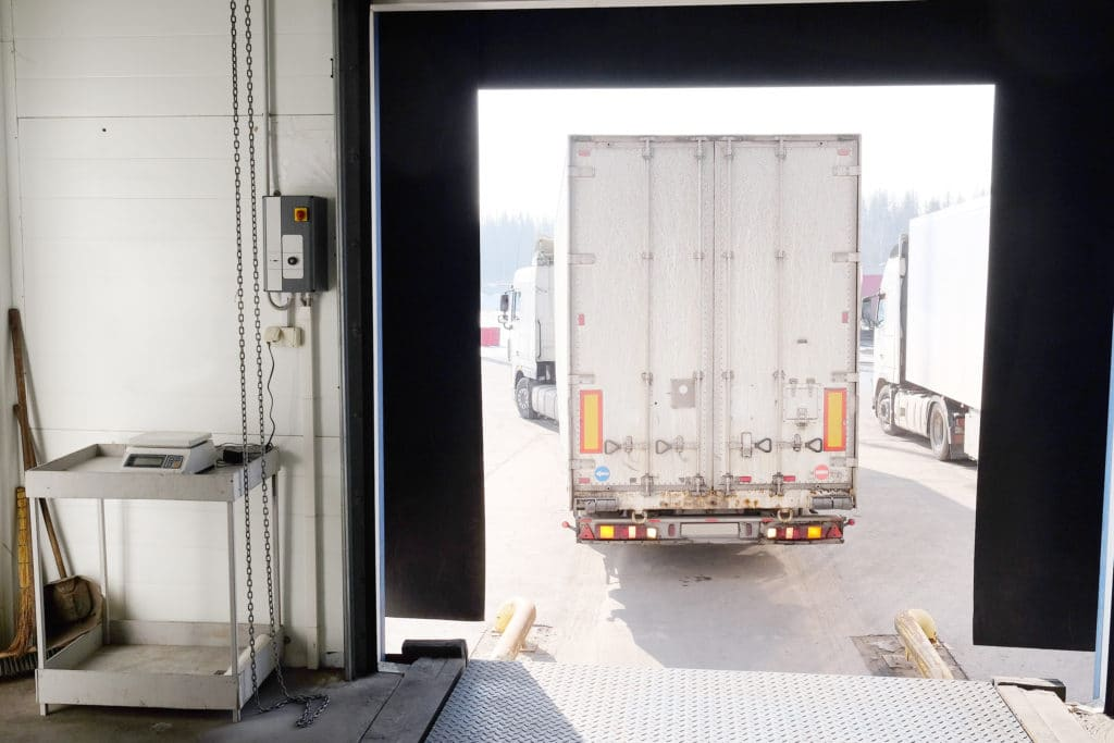 Truck backing into a loading dock