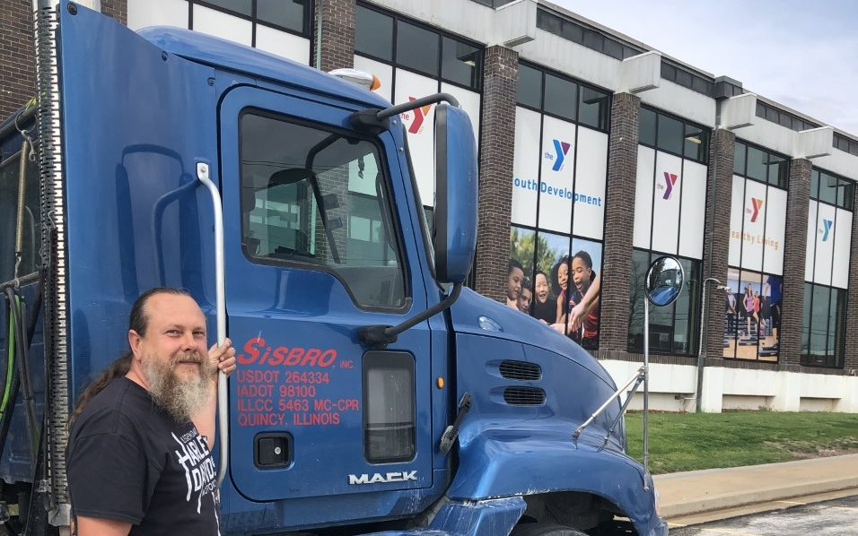 Sisbro truck and driver outside Quincy, Illinois YMCA