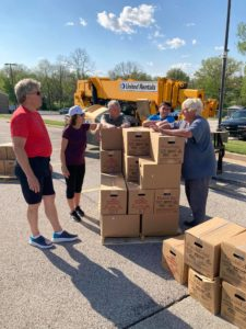 Volunteers and USDA food boxes in Quincy, Illinois YMCA parking lot