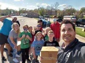 Quincy, IL YMCA staff and volunteers in parking lot with food boxes