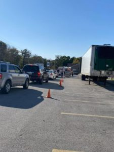 Line of cars by Sisbro trailer in Quincy, Illinois YMCA parking lot
