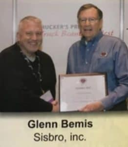 Glenn Bemis, Sisbro General Manager, accepting 2018 award for Western Outstanding Member of the Year at the 2019 Mid-West Truckers Association Convention