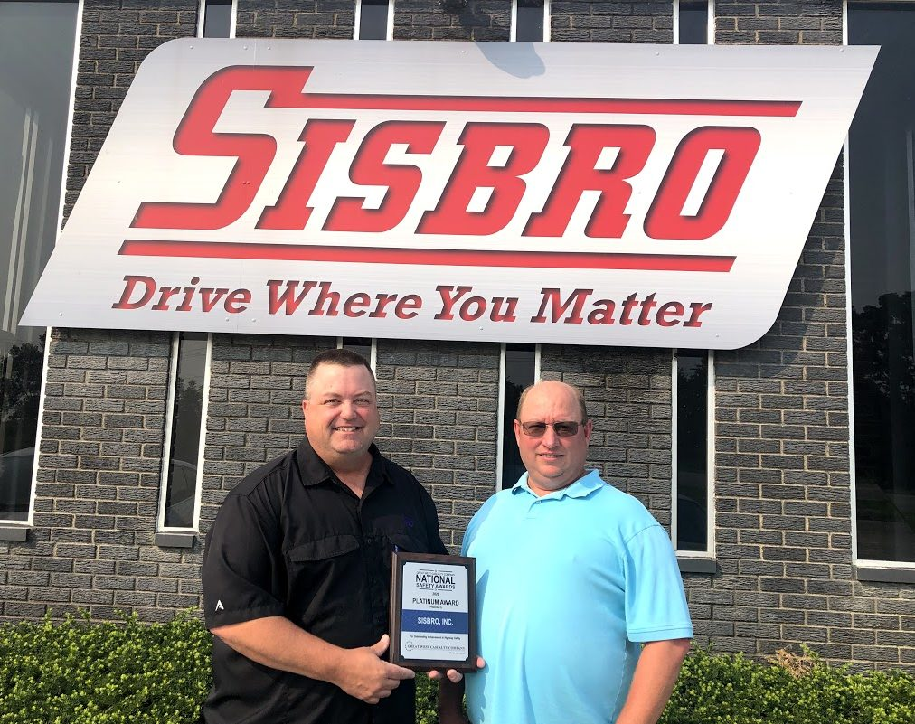 Great West Casualty Company Safety Representative presenting Sisbro Director of Safety Glenn Meyers with 2020 Platinum plaque for National Safety Award